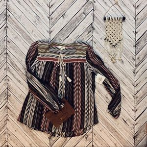 NEW Patterned blouse with tassels